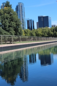 Downtown skyline reflected in canal